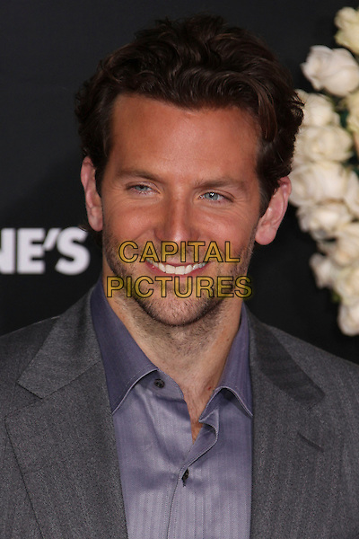 "BRADLEY COOPER .Arrivals to the world premiere of ""Valentine's Day"" at Grauman's Chinese Theater in Hollywood, California, USA. .February 8th, 2010. .portrait headshot stubble facial hair  grey gray jacket shirt tanned smiling .CAP/CEL.©CelPh/Capital Pictures"