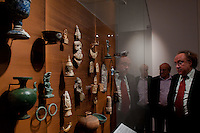 Visitor watches artifacts on display in the Southeast Gold Museum that presents hundreds of golden artifacts from the private collection of founder Istvan Zelnik in Budapest, Hungary on September 15, 2011. ATTILA VOLGYI