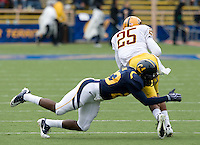 Josh Hill of California tackles Deantre Lewis of ASU during the game at Memorial Stadium in Berkeley, California on October 23rd, 2010.  California defeated Arizona State, 50-17.