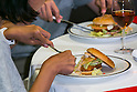 Customers enjoy eating Fresh Mac burgers with fork and knife as a part of McDonald's special dinner during a ''Restaurant M'' event in the posh Roppongi Hills area on July 27, 2015, Tokyo, Japan. 20 chosen diners (from 8,300 applications) ate a special multi-course dinner created by the celebrity chef using ingredients from the restaurant chain's regular menu. The special one-night only event was organized to celebrate the launch of its new summer menu ''Fresh Mac,'' which features fresh vegetables. The five-course meal served on a white tablecloth with plates and proper cutlery included a Vichyssoise en Pommes de terre de McDonald, Mousse au Poivron Rouge, Salade en Gelee aux Legumes de McDonald, Cinq Pinchos des McDonald Patties avec leur Sauces, a choice of main dish including the Fresh Mac Bacon Lettuce Burger, and a McFlurry Mixed Berry Oreo dessert with a Premium Roast Coffee. (Photo by Rodrigo Reyes Marin/AFLO)