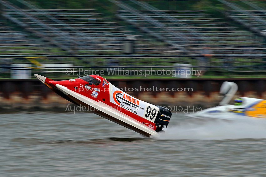 Frame 8: Mike Beegle, (#99) gets light coming down the front straight, hangs the boat, then finally blows over coming to rest upside-down.