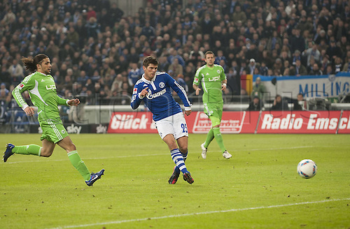 19.02.2012. Gelsenkirchen, Germany.  Schalke 04 versus VfL Wolfsburg. Klaas Jan Huntelaar Ge shoots and scores the goal for 2-0 against Ricardo Rodriguez