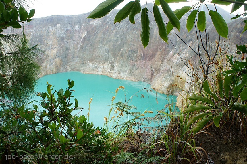 blue lake, vulcano Kelimutu, island  Flores in archipelago of Indonesia.Locals in village Moni believe, the souls of passed village members  go into the lake. Changing colors of the lakes (caused by minerals) would signify, these souls are angry.