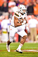 Charlotte, NC - DEC 2, 2017: Miami Hurricanes running back Travis Homer (24) runs the football during ACC Championship game between Miami and Clemson at Bank of America Stadium Charlotte, North Carolina. (Photo by Phil Peters/Media Images International)