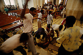 Port-au-Prince, Haiti<br /> November 1987<br /> <br /> A suspected ton-ton-macoute is wrestled to the floor in a Cathedral prior to elections held on November 29th, the first attempt at a democratic election in Haiti. It was unsuccessful as 34 people were killed at a polling station and elections were moved up to February 1988.<br /> <br /> Leslie Fran&ccedil;ois Manigat won the election with many political parties boycotting. He had military backing but once in office he sought greater control over the military in an effort, to fight corruption. Manigat's government was overthrown by General Henri Namphy within months.