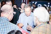 Republican presidential candidate and Ohio governor John Kasich speak with members of the audience and the media after a town hall campaign event at the Derry VFW in Derry, New Hampshire.