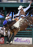 Tyrel Larsen rides in the saddle bronc competition at the Reno Rodeo in Reno, Nev. on Friday, June 19, 2015.<br /> Photo by Cathleen Allison/Nevada Photo Source