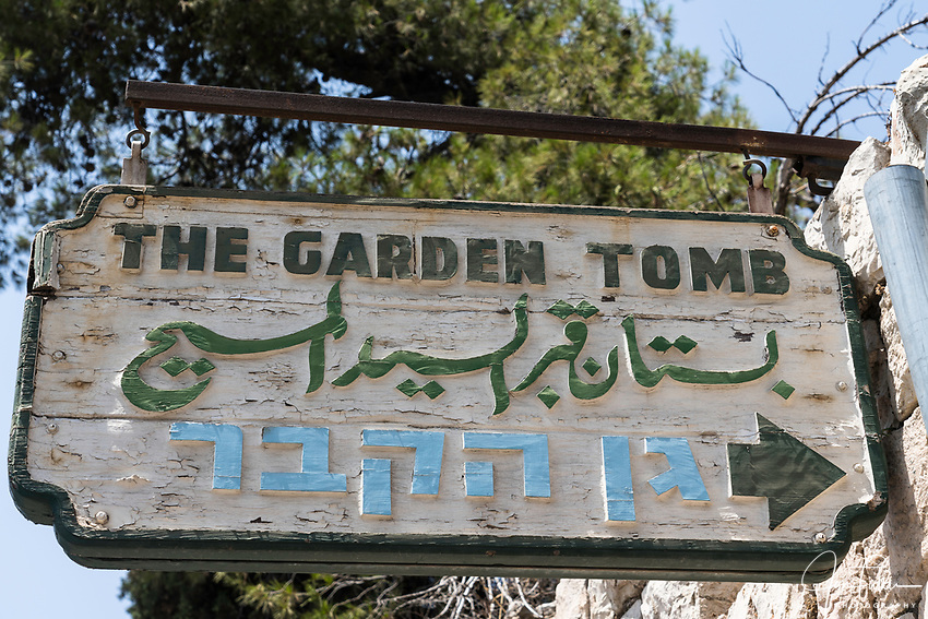 A wooden sign for the Garden Tomb in Jerusalem, just north of the Damascus Gate and outside the walls of the ancient city.  The Garden Tomb is thought by many to be the burial place of Jesus Christ, rather than in the Church of the Holy Sepulchre.  Nearby is a hill thought by many to be Golgotha, the site of the crucifixion of Christ.