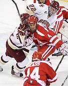 Steven Whitney (BC - 21), Adam Clendening (BU - 4), Paul Carey (BC - 22) - The Boston College Eagles defeated the visiting Boston University Terriers 5-2 on Saturday, December 4, 2010, at Conte Forum in Chestnut Hill, Massachusetts.