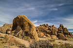 Boulders set against a partly cloudy sky in the Alabama Hills near Lone Pine.