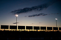 Sep 27, 2019; Madison, IL, USA; NHRA fans in the crowd during sunset to qualifying for the Midwest Nationals at World Wide Technology Raceway. Mandatory Credit: Mark J. Rebilas-USA TODAY Sports