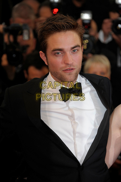 Robert Pattinson.'Cosmopolis' screening at the 65th  Cannes Film Festival, France..25th May 2012.headshot portrait black white bow tie tuxedo stubble facial hair rob.CAP/PL.©Phil Loftus/Capital Pictures.
