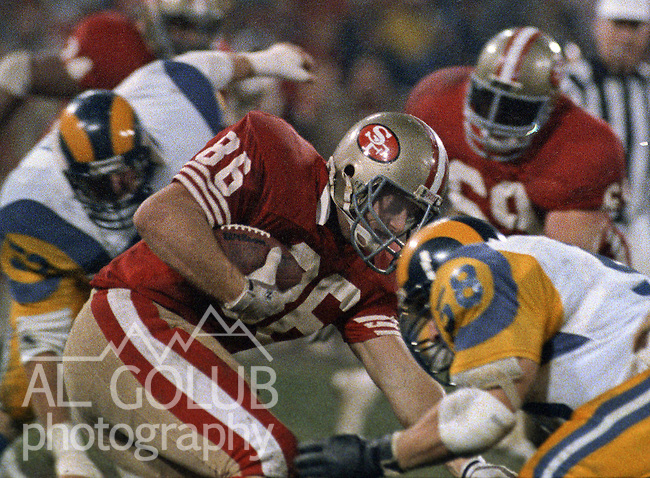 San Francisco 49ers vs Los Angles Rams at Candlestick Park Sunday, December 27, 1987..49ers beat Falcons 48-0.San Francisco 49ers Tight End John Frank (86) tackled by Los Angles Rams Linebacker Mel Owens (58)..