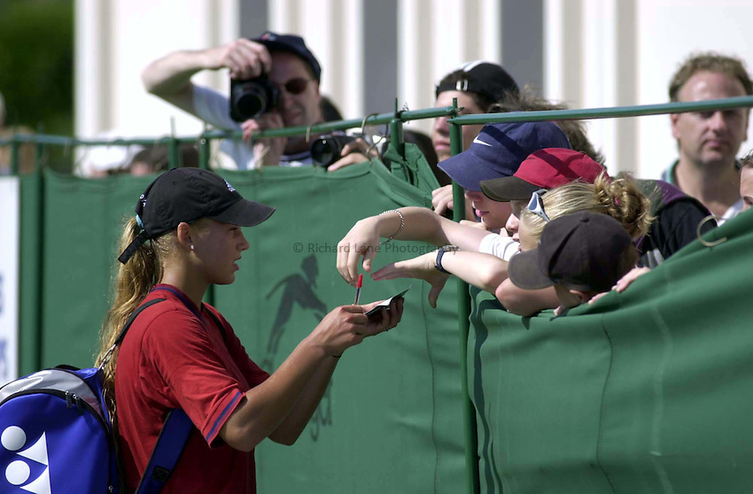 Photo. Richard Lane. .Direct Line International Ladies Tennis Championships, Eastbourne. 19/6/2000.Anna Kournikova signs autographs after an afternoon knock up.