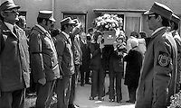 A UDA guard of honour in para-military uniform stands to attention as the coffin of murdered Citybus inspector, Alexander Millar, is carried from his home in North Belfast, N Ireland, UK.  Millar, described as a captain in the UDA, Ulster Defence Association, was shot dead in his office in Ardoyne Bus Station after he was singled out by a gunman and an associate on 2nd May 1975. Although a UDA member would have been an obvious target for the Provisional IRA no claim or counter-claim was made to this effect. <br />
