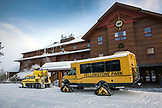 USA, Wyoming, Yellowstone National Park, a Snowcoaches are ready to transport visitors for day excursions or North to Mammoth Hot Springs, the Snow Lodge at Old Faithful