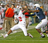 Ohio State Buckeyes running back Dontre Wilson (2) is run out of bounds after a gain in the third quarter by Penn State Nittany Lions safety Adrian Amos (4)at Beaver Stadium on October 25, 2014.  (Chris Russell/Dispatch Photo)