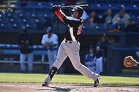 Hickory Crawdads first baseman Ronald Guzman (20) swings at a pitch during game one of a double header against the Asheville Tourists on April 21, 2015 in Asheville, North Carolina. The Crawdads defeated the Tourists 10-1. (Tony Farlow/Four Seam Images)