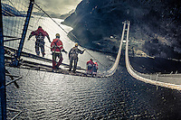 HSM Offshore steelworkers crossing over Dalsfjord on catwalk.