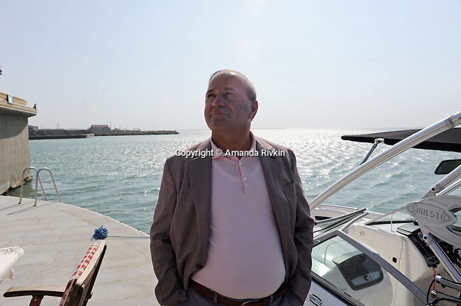 Ibrahim Ibrahimov, an Azerbaijani oligarch and billionaire, is seen at the edge of the Caspian Sea outside one of several of his homes in the Garadagh region just southwest of Baku, Azerbaijan on July 18, 2012.  Ibrahimov is the developer behind the Khazar Islands artificial islands project; in his private life, he enjoys building a home for his family, moving in, and then quickly tires of the property before building a new home on an adjacent lot on his seaside lands.