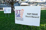 Team signage at Pier 84 in Hudson River Park for a 5K charity run.