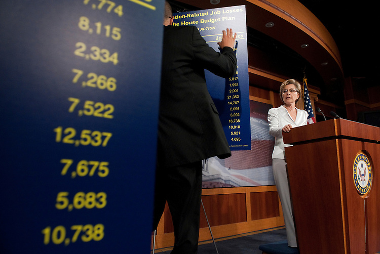 UNITED STATES - JULY 6: Senate staff puts up charts of expected transportation related job losses due to the House budget plan as Senate Environment and Public Works Chairwoman Barbara Boxer, D-Calif. holds a news conference on transportation and jobs on Wednesday, July 6, 2011. (Photo By Bill Clark/Roll Call)