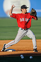 Infielder/third baseman Carlos Asuaje (20) of the Greenville Drive works out on the team's Media Day first workout on Tuesday, April 1, 2014, at Fluor Field at the West End in Greenville, South Carolina. (Tom Priddy/Four Seam Images)