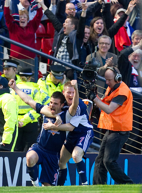 Steven Craig celebrates his goal for Ross County wth Michael Gardyne