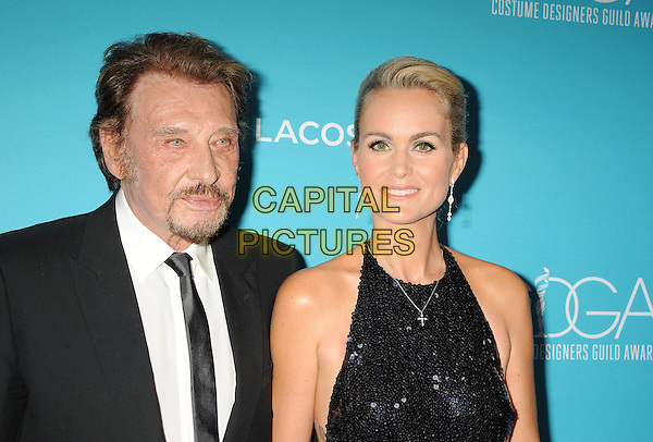 BEVERLY HILLS, CA - FEBRUARY 17: Singer Johnny Hallyday (L) and wife Laeticia Hallyday attend the 17th Costume Designers Guild Awards at The Beverly Hilton Hotel on February 17, 2015 in Beverly Hills, California.<br /> CAP/ROT/TM<br /> &copy;TM/ROT/Capital Pictures