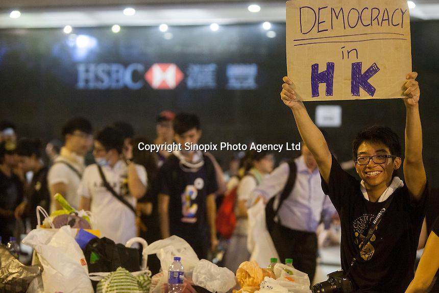 An Occupy Central pro-democracy protester is seen on the second day of the mass civil disobedience campaign Occupy Central, Central District, Hong Kong, China, 30 September 2014. The movement is also being dubbed the 'umbrella revolution' after the versatile umbrellas used to shield protesters from rain, sun - and police pepper spray.