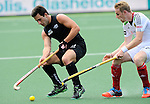 The Hague, Netherlands, June 08: Kane Russell #21 of New Zealand controls the ball during the field hockey group match (Men - Group B) between the Black Sticks of New Zealand and Germany on June 8, 2014 during the World Cup 2014 at Kyocera Stadium in The Hague, Netherlands.  Final score 3-5 (1-3) (Photo by Dirk Markgraf / www.265-images.com) *** Local caption ***