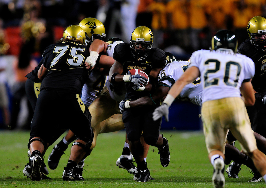 31 Aug 2008: Colorado tailback Demetrius Sumler carries the ball against Colorado State. The Colorado Buffaloes defeated the Colorado State Rams 38-17 at Invesco Field at Mile High in Denver, Colorado.. FOR EDITORIAL USE ONLY