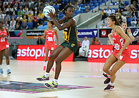 04.09.2016 South Africa's Bongiwe Msomi in action during the Netball Quad Series match between England and South Africa played at Margaret Court Arena in Melbourne. Mandatory Photo Credit ©Michael Bradley.
