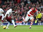 Arsenal's Olivier Giroud tussles with Aston Villa's Jores Okore<br /> <br /> Barclays Premier League - Arsenal vs Aston Villa - Emirates Stadium  - England - 1st February 2015 - Picture David Klein/Sportimage