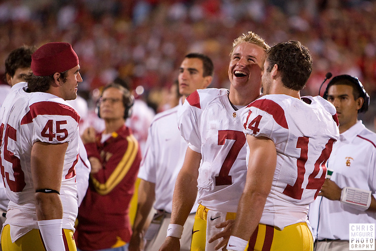 12 September 2009:  Football -- USC quarterback Matt Barkley (7) laughs with backup quarterback Garrett Green (14) at the end of their game against Ohio State at Ohio Stadium in Columbus.  USC won 18-15.  Photo by Christopher McGuire.