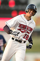 Kannapolis center fielder Paulo Orlando (#18) is all smiles as he rounds third base following his first inning home run versus Asheville at Fieldcrest Cannon Stadium in Kannapolis, NC, Friday, April 14, 2006.  It would be the only run on the evening for the Intimidators as they fell to the Tourists by the score of 12-1.