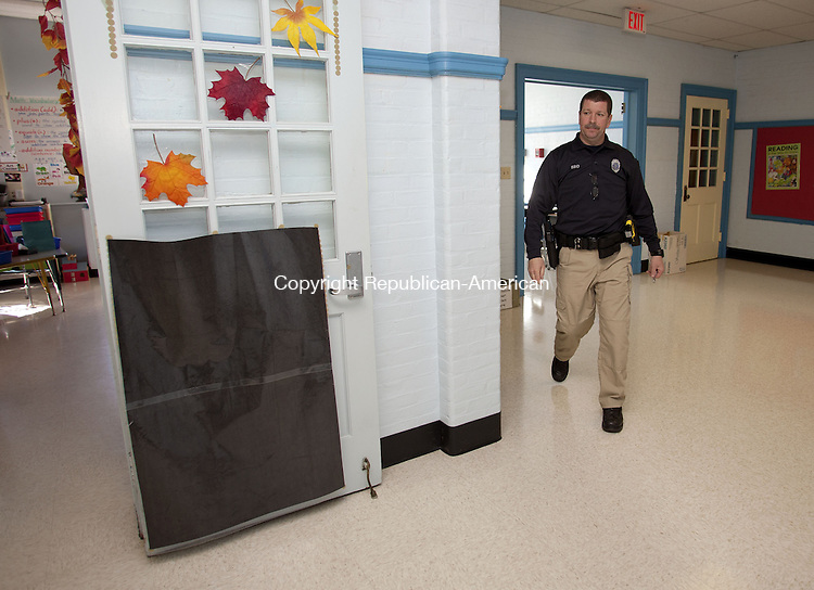 WOODBURY, CT-13 November 2013-111313BF03- School Resource Officer Craig Tibbals checks safety and visits with students and teachers daily at Mitchell Elementary School in Woodbury. Officer Craig, as he is known to students, started as the school resource officer at the school in September and is at the school each day students are present. Bob Falcetti Republican-American