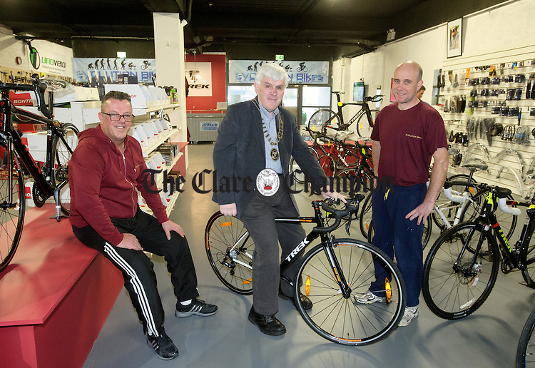 Mayor of Ennis Pat Daly with co-owners Alan Quigley and Gary Mc Donald at the official opening of Evolution Bikes at Hawthorn house, Clare Road, Ennis. Photograph by John Kelly.