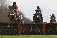 Race winner Open Hearted ridden by Jeremiah McGrath (L) in jumping action during the European Breeders Fund National Hunt Novices Hurdle
