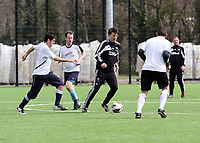 Thursday 11 April 2013<br /> Pictured: Michael Laudrup (3rd L) against three sports reporters.<br /> Re: Friendly game, Swansea City FC coaching staff v sports reporters at the Swansea City FC training ground. Final score 10-4.