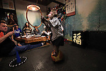 """October 22, 2016, Utsunomiya, Japan - A Japanese macaque Fuku (meaning happiness) balances on a ball and receives a ring thrown by a guest at an izakaya, Japanese pub """"Kayabuki"""" in Utsunomiya, 100km north of Tokyo on Saturday, October 22, 2016. The pub master Kaoru Otsuka trains Japanese macaques to help him and show their entertainment skills to attract customers including lots of foreign tourists.   (Photo by Yoshio Tsunoda/AFLO) LWX -ytd-"""