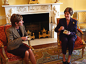 Laura Bush hosts a visit from Katalin Medgyessy, wife of  Prime Minister Peter Medgyessy of the Republic of Hungary, in the Yellow Oval Room in the private residence of the White House on Friday, November 8, 2002. <br /> Mandatory Credit: Tina Hager / White House via CNP