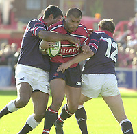 Photo Peter Spurrier.12/10/2002.Heineken European Cup Rugby.Gloucester vs Munster - Kingsholm.Gloucester's Robert Todd, breaking through Munster's, defensive line of  Jim William left and Rob Henderson right