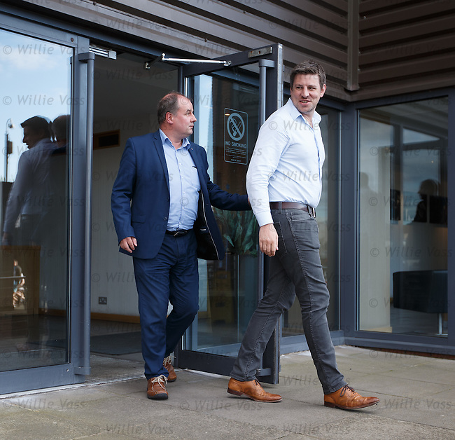 Chris Graham and Richard Scott from the RST and RF emerge from Albion House