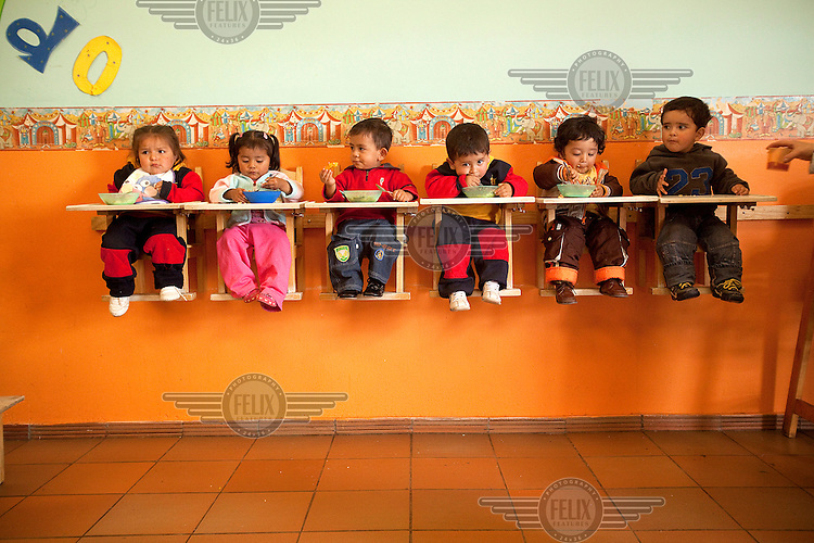 Children eat lunch in a creche at M G Consultores, a flower plantation in Chia.