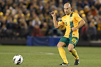 MELBOURNE, 11 JUNE 2013 - Mark BRESCIANO of Australia kicks the ball in a Round 4 FIFA 2014 World Cup qualifier match between Australia and Jordan at Etihad Stadium, Melbourne, Australia. Photo Sydney Low for Zumapress Inc. Please visit zumapress.com for editorial licensing. *This image is NOT FOR SALE via this web site.