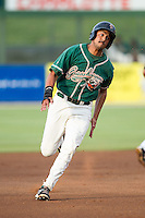 Carlos Lopez (7) of the Greensboro Grasshoppers hustles towards third base against the Kannapolis Intimidators at CMC-Northeast Stadium on June 12, 2014 in Kannapolis, North Carolina.  The Grasshoppers defeated the Intimidators 5-2.  (Brian Westerholt/Four Seam Images)