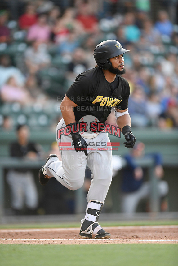 First baseman Onil Pena (32) of the West Virginia Power runs toward first base in a game against the Greenville Drive on Friday, May 17, 2019, at Fluor Field at the West End in Greenville, South Carolina. West Virginia won, 10-4. (Tom Priddy/Four Seam Images)