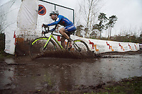 Alice Maria Arzuffi (ITA) splashing by<br /> <br /> Women U23 Race<br /> UCI 2016 cyclocross World Championships