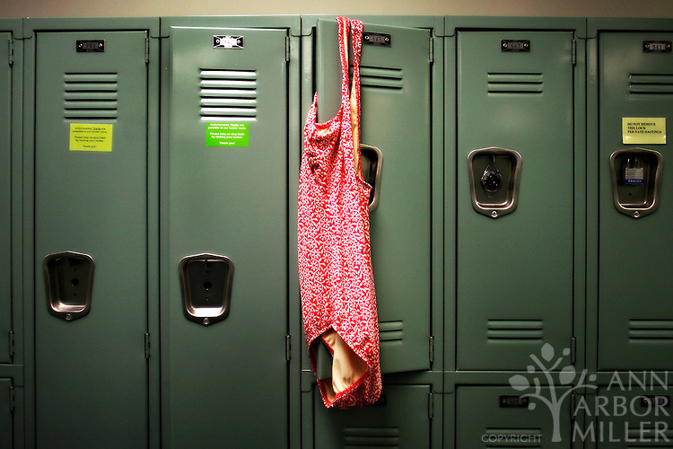 Bea Ihlenfeld's swimsuit hangs on a locker in the members' locker room at the Fargo-Moorhead Family YMCA Downtown Branch. Ihlenfeld has been a fixture at the Y for 34 years. Ann Arbor Miller / The Forum
